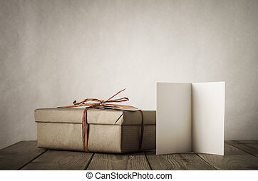 Simple Gift Box and Card on Table - A gift box wrapped in...