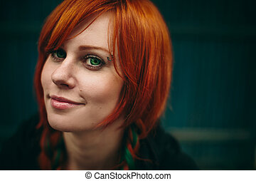 Beautiful red hair girl with deep green eyes