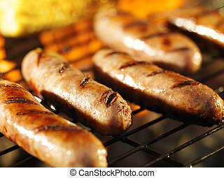 bratwursts on grill with corn close up