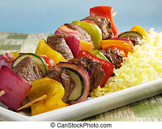 Beef Kabobs with Saffron Rice - Juicy beef kabobs with bell...