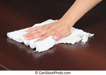 Wiping surface - Housekeeper polishing wooden table