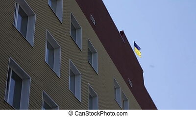 flag of Ukraine on the building - flag of Ukraine waving on...