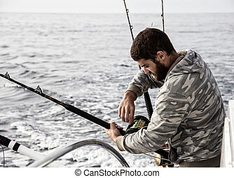 Fisherman - Tuna fisherman in action at sea