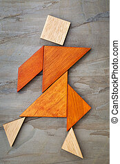 tangram dancing figure - abstract of a dancing or walking...