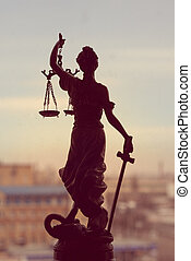 picture of goddess Themis or Lady Justice standing on window...