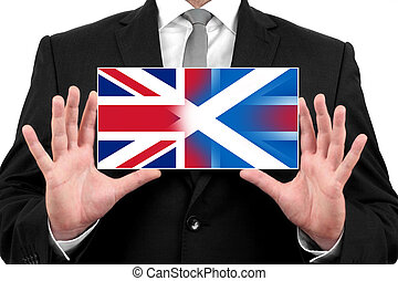 Businessman holding business card with Scotland and United...