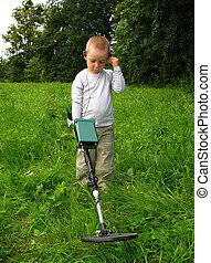 Searching - Little boy with metal detector
