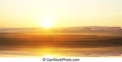 sunrise over mountain lake.
