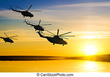 Helicopters at sunset in the sky