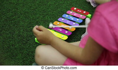 girl playing the xylophone close-up
