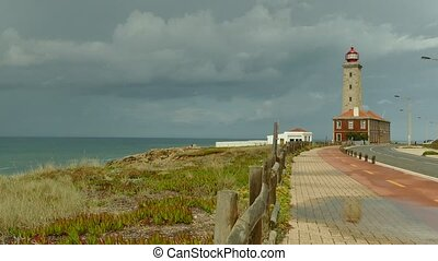 Lighthouse at Sao Pedro de Moel - Sea and lighthouse on a...