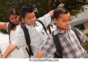 Cute Brothers and Sister Having Fun Walking to School