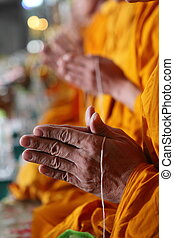 Pray, the monks and religious rituals in Buddhist ceremony