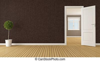 Empty brown room with open door
