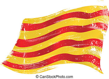 Catalan grunge flag - flag of Catalonia in the wind with a...