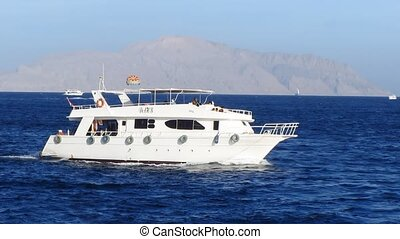 Motor yacht - White motor yacht at open sea in Egypt