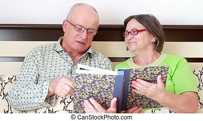 Senior Couple Watching Photo Album - Senior couple watching...