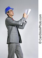 Architect engineer with blue hardhat and suit isolated on...