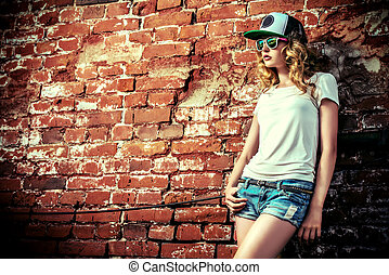 t-shirt style - Beautiful modern girl near the brickwall....