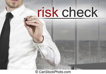 businessman writing risk check in the air - businessman in...