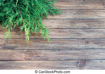 Christmas-tree branch on a wooden background