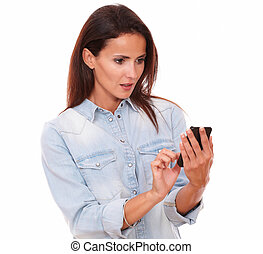Surprised hispanic female reading a text - Portrait of...