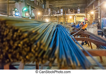 Worker in reinforcing shop - Tyumen, Russia - August 13,...