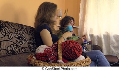 wool balls and women knit - Basket full of wool balls and...