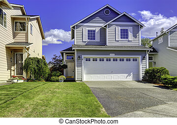 Cozy house exterior with garage - Two story house with small...