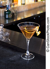 Orange Martini - An orange martini on a granite bar