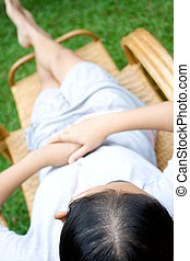 relaxing woman on bamboo lazy chair