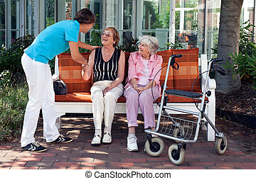 Young care assistant introducing herself to the friend of...