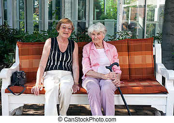 Two senior women enjoying a day outdoors