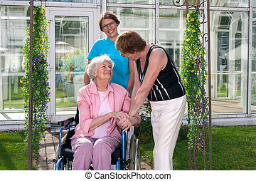 Two Health Care Professionals for Old Age Patient on Wheel...