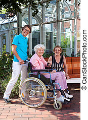 Happy Caregivers and Elderly Portrait - Happy Caregivers and...
