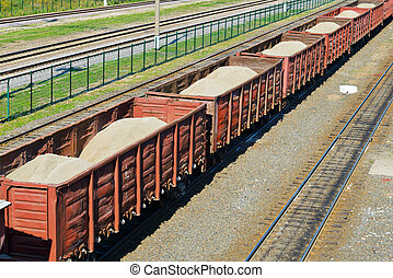 Rail freight wagons with sand - Freight train, the rail...