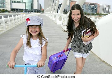 Little student girls going to school in city - Little girls...