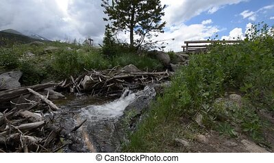 Flowing Creek and small bridge near - Flowing creek, water...