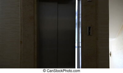 Modern elevator in the hall. Open and close door motion