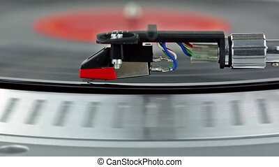 Close view of a record playing on a - An old record playing...