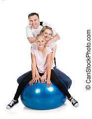 Young Family Doing Fitness Together