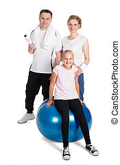 Young Family Standing In Fitness Outfit. Isolated On White