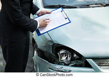 Insurance Agent Inspecting Car After Accident - Midsection...