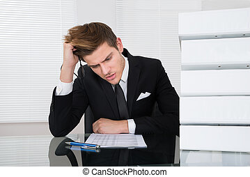 Worried Businessman Reading Document - Worried young...