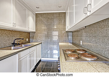 Modern kitchen with tile trim - White kitchen cabinets with...