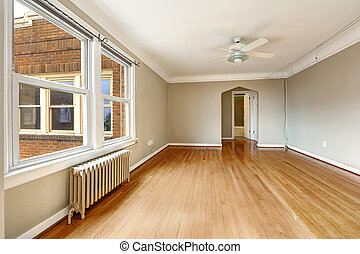 Old apartment interior Empty living room with radiator -...