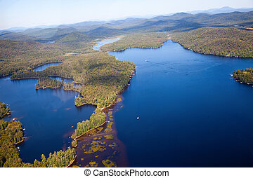 Adirondack forests and lakes summer aerial view from light...