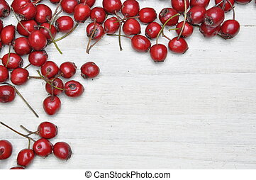 Hawthorn berries on wooden table