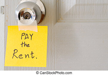 sticky note write a message pay the rent