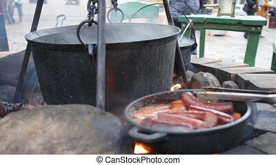 mulled wine - huge copper cauldron with the tasty mulled...